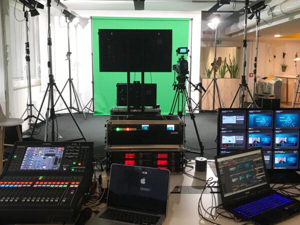 <span>Streaming & Broadcast</span><i>→</i>